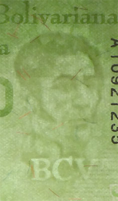 Piece bbcv20000bss-aa01-a8 (Obverse, partial, in front of light)